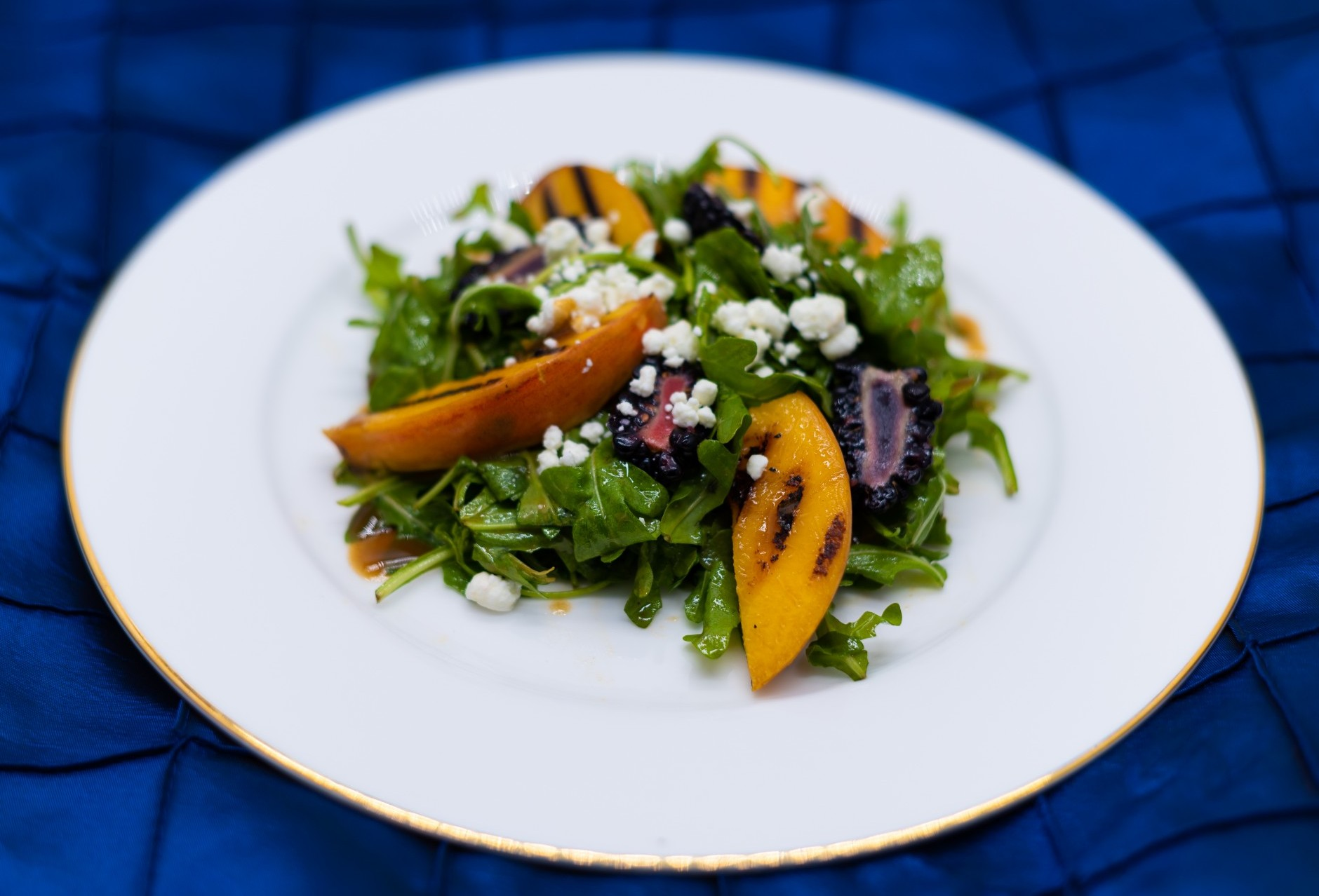 Grilled Peaches and Arugula Salad with Blackberries Crumbled Goat Cheese and Balsamic Vinegar Dressing