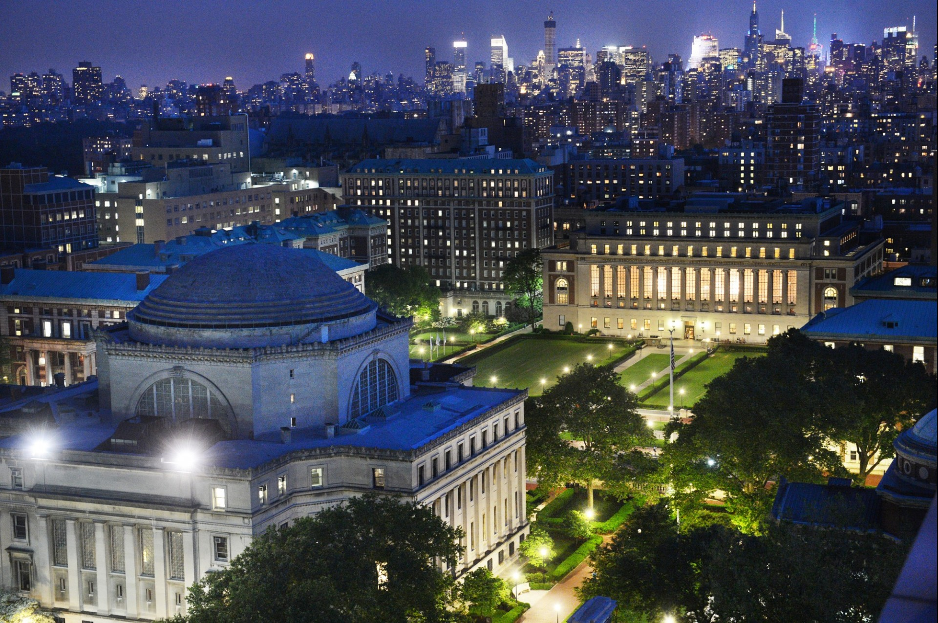 An aerial view of Columbia University's Morningside Campus at night.