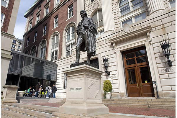 A statue of Thomas Jefferson stands at the front of the Columbia Journalism School